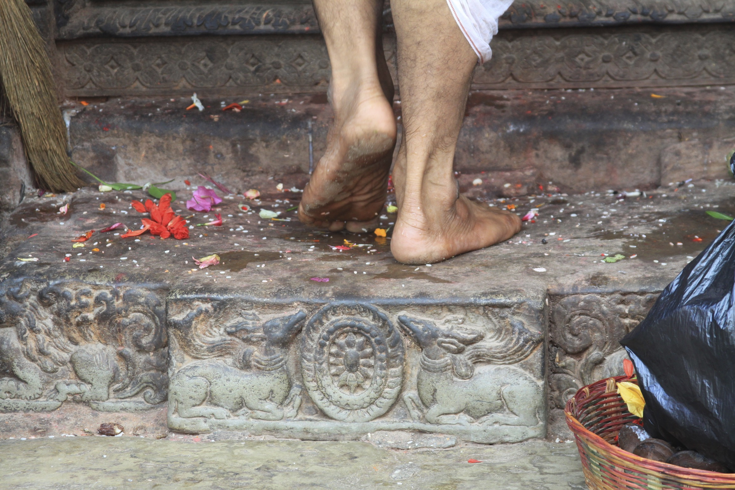 A hindu priest walking into the Temple
